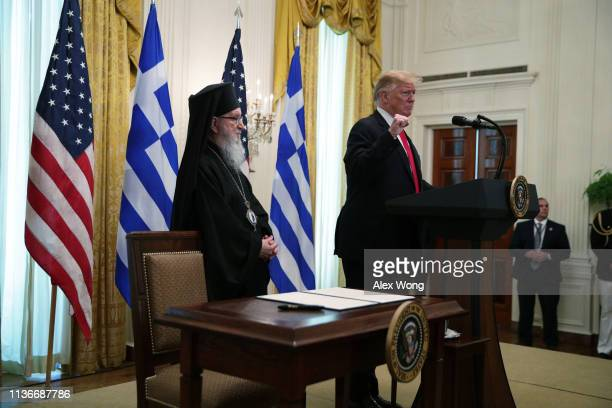 US President Donald Trump speaks as Archbishop Demetrios Geron of America listens during a Greek Independence Day celebration in the East Room of the...