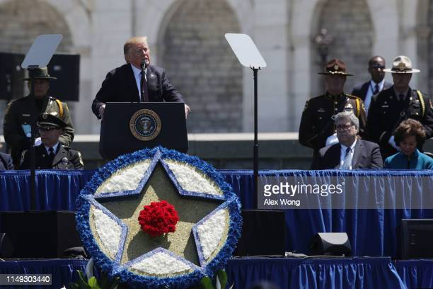S President Donald Trump speaks as Attorney General William Barr listens during the 38th Annual National Peace Officers' Memorial Service at the west...