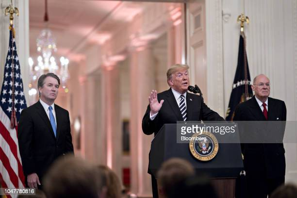 US President Donald Trump speaks as Brett Kavanaugh associate justice of the US Supreme Court left and Anthony Kennedy former associate justice of...