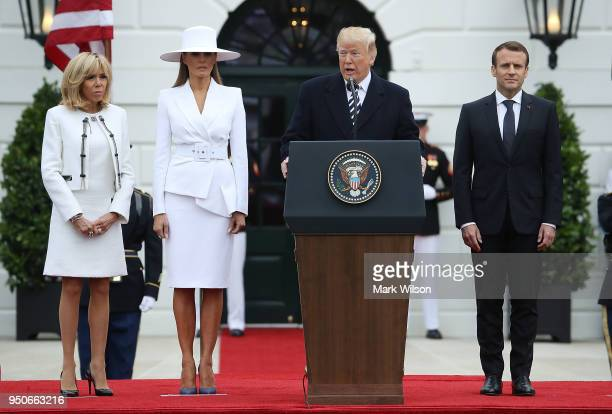 President Donald Trump speaks as Brigitte Macron first lady Melania Trump French President Emmanuel Macron attend a state arrival ceremony hosted by...