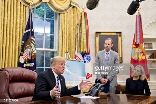US President Donald Trump speaks as Brock Long administrator of the Federal Emergency Management Agency center and Kirstjen Nielsen US secretary of...