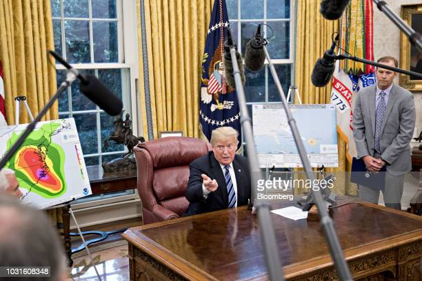 US President Donald Trump speaks as Brock Long administrator of the Federal Emergency Management Agency right listen during a meeting with the...