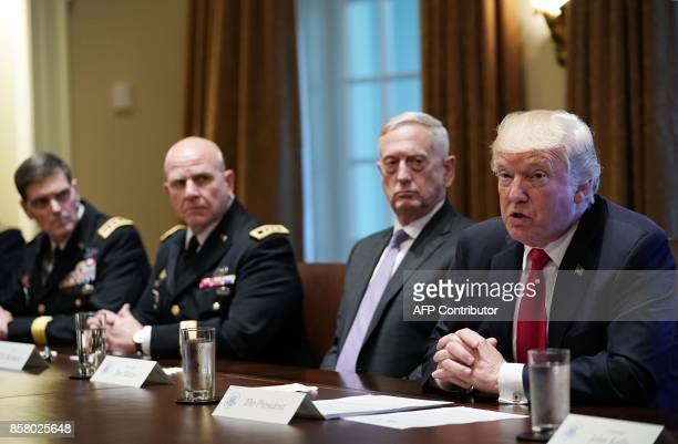 US President Donald Trump speaks as Defense Secretary James Mattis looks on during a meeting with senior military leaders in the Cabinet Room of the...