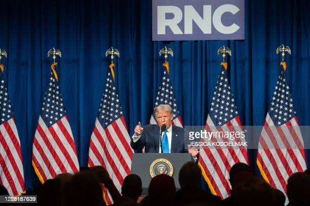 President Donald Trump speaks as delegates gather during the first day of the Republican National Convention on August 24 in Charlotte, North...