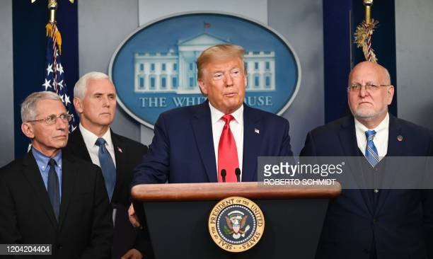 US President Donald Trump speaks as Director of the National Institute of Allergy and Infectious Diseases at the National Institutes of Health...