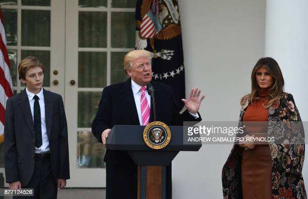 US President Donald Trump speaks as First Lady Melania Trump and their son Barron look on before a turkey pardoning ceremony at the White House in...