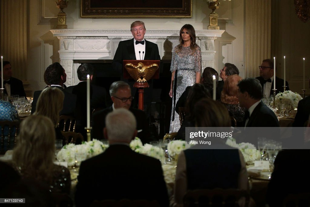 U.S. President Donald Trump speaks as first lady Melania Trump listens during a reception at the State Dining Room of the White House September 14, 2017 in Washington, DC. President Trump and the first lady hosted a reception for the White House Historical Association.