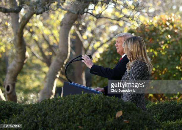President Donald Trump speaks as first lady Melania Trump looks on as he prepares to give the National Thanksgiving Turkey a presidential pardon...