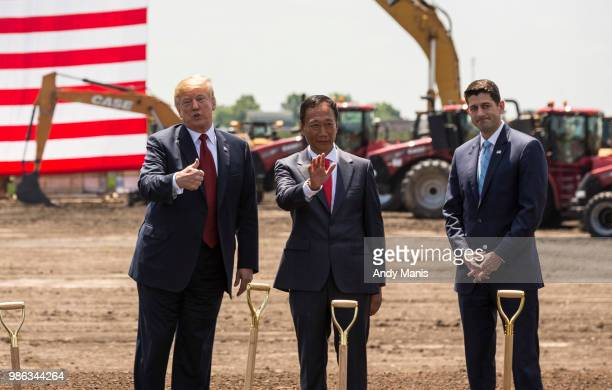 S President Donald Trump speaks as Foxconn CEO Terry Gou and US House Speaker Paul Ryan watch at the groundbreaking for the Foxconn Technology Group...