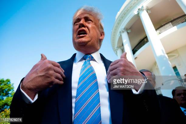 President Donald Trump speaks as he departs the White House in Washington, DC, on July 29, 2020 en route to Texas.
