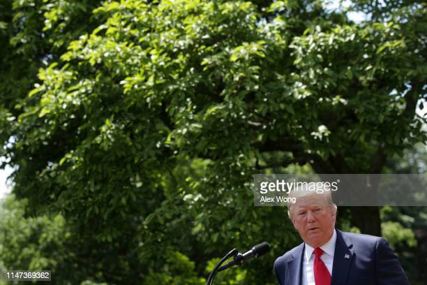 President Donald Trump speaks as he hosts the U.S. Military Academy football team, the Army Black Knights, in the Rose Garden of the White House May...