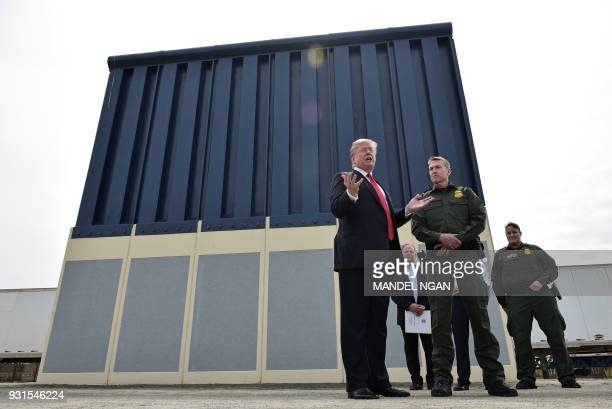 US President Donald Trump speaks as he inspects border wall prototypes in San Diego California on March 13 2018 / AFP PHOTO / MANDEL NGAN