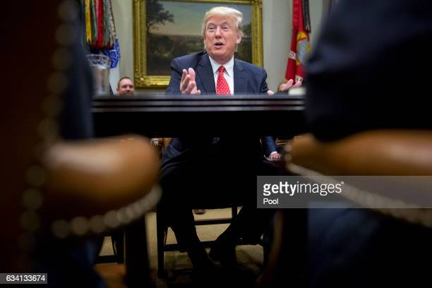 US President Donald Trump speaks as he meets with county sheriffs during a listening session in the Roosevelt Room of the White House on February 7...
