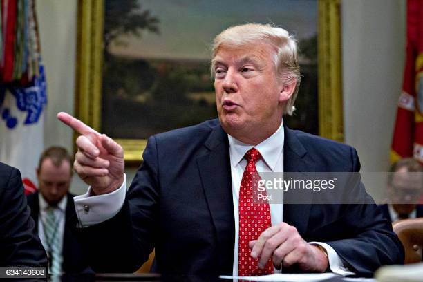 President Donald Trump speaks as he meets with county sheriffs during a listening session in the Roosevelt Room of the White House on February 7,...