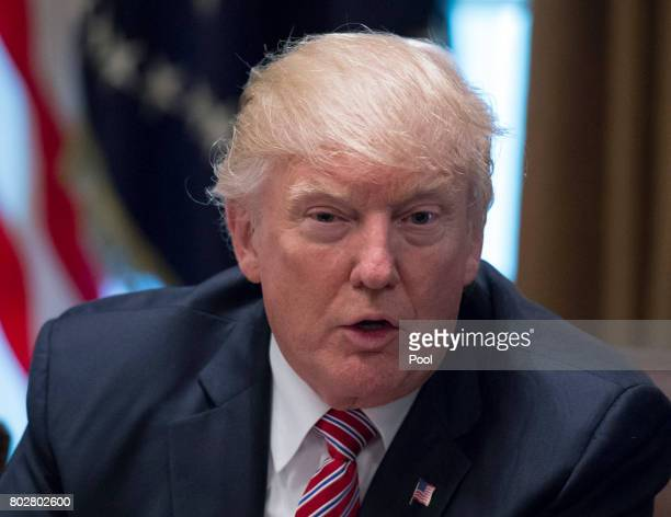President Donald Trump speaks as he meets with immigration crime victims to urge passage of House legislation to save American lives in the Cabinet...