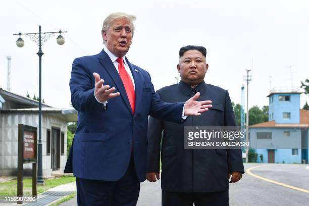 President Donald Trump speaks as he stands with North Korea's leader Kim Jong Un south of the Military Demarcation Line that divides North and South...