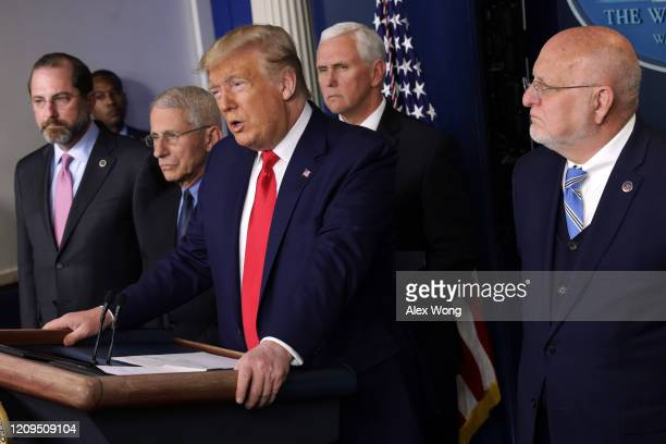 President Donald Trump speaks as Health and Human Services Secretary Alex Azar, National Institute for Allergy and Infectious Diseases Director...