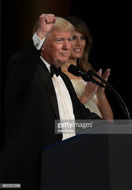 President Donald Trump speaks as his wife First Lady Melania Trump looks on during A Salute To Our Armed Services Inaugural Ball at the National...