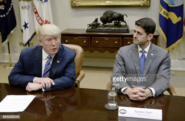 President Donald Trump speaks as House Speaker Paul Ryan listen during a meeting with House and Senate leadership in the Roosevelt Room of the White...
