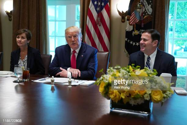 "S President Donald Trump speaks as Iowa Gov Kim Reynolds and Arizona Gov Doug Ducey listen during a working lunch with governors on ""workforce..."