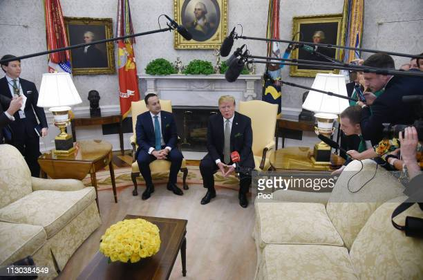 US President Donald Trump speaks as Ireland Prime Minister Leo Varadkar listens during a meeting in the Oval Office of the White House on March 14...