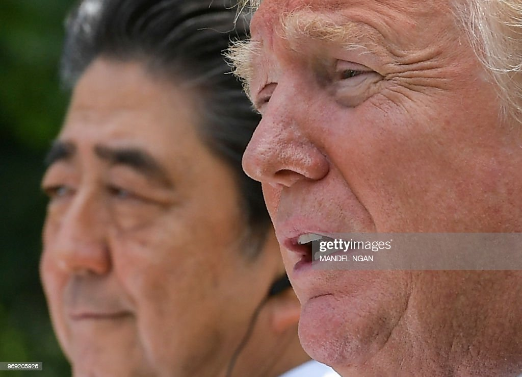 US President Donald Trump speaks as Japan's Prime Minister Shinzo Abe looks on during a joint press conference in the Rose Garden of the White House on June 7, 2018 in Washington, DC.