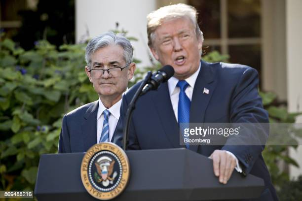 US President Donald Trump speaks as Jerome Powell governor of the US Federal Reserve and Trumps nominee as chairman of the Federal Reserve left...