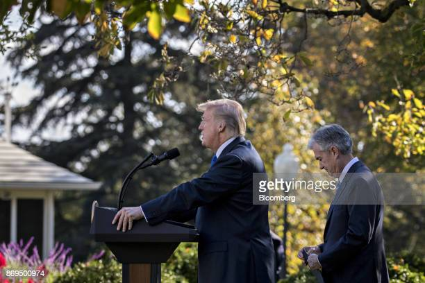 US President Donald Trump speaks as Jerome Powell governor of the US Federal Reserve and Trump's nominee as chairman of the Federal Reserve right...