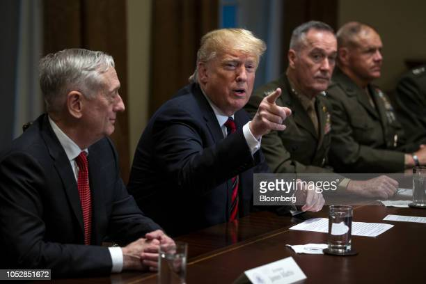 US President Donald Trump speaks as Jim Mattis US secretary of defense left and General Joseph Dunford chairman of the Joint Chiefs of Staff right...