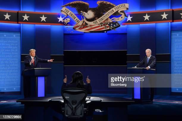 President Donald Trump speaks as Joe Biden, 2020 Democratic presidential nominee, right, listens during the U.S. Presidential debate at Belmont...