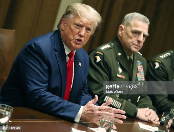 S President Donald Trump speaks as Joint Chiefs of Staff Chairman Army General Mark Milley looks on after a briefing from senior military leaders in...