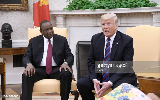 S President Donald Trump speaks as Kenyan President Uhuru Kenyatta looks on during a bilateral meeting in the Oval Office of the White House August...