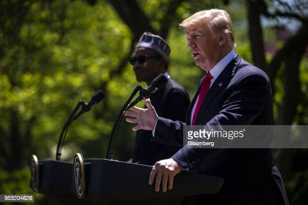 US President Donald Trump speaks as Muhammadu Buhari Nigeria's president left listens during a news conference in the Rose Garden of the White House...