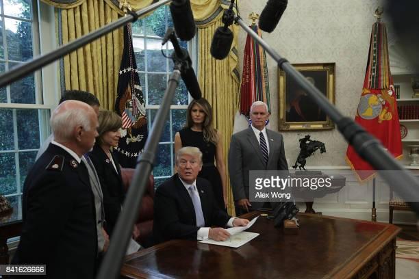 S President Donald Trump speaks as National Commander of The Salvation Army Colonel David Hudson American Red Cross President CEO Gail McGovern first...