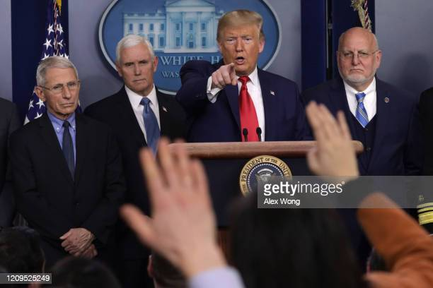President Donald Trump speaks as National Institute for Allergy and Infectious Diseases Director Anthony Fauci, Vice President Mike Pence, and...
