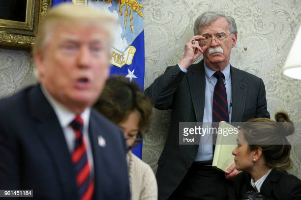 President Donald Trump speaks as National security advisor John Bolton listens during a meeting with South Korean President Moon Jaein in the Oval...