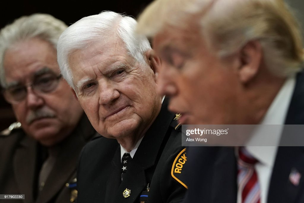 S. President Donald Trump speaks as President of the National Sheriffs Association Harold Eavenson of Rockwall County Sheriff's Office in Texas looks on during a meeting in the Roosevelt Room of the White House February 13, 2018 in Washington, DC. President Trump met with representatives of the association to discuss law enforcement.