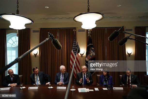 S President Donald Trump speaks as Rep Brian Mast Sen Christopher Murphy Senate Majority Whip Sen John Cornyn Sen Dianne Feinstein and Sen Marco...