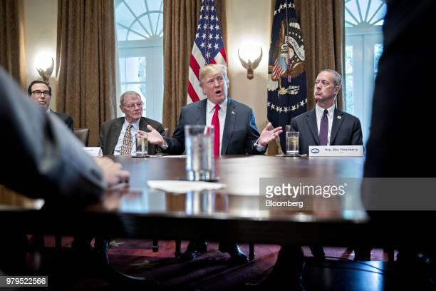 US President Donald Trump speaks as Representative Mac Thornberry a Republican from Texas right Senator James Inhofe a Republican from Oklahoma...