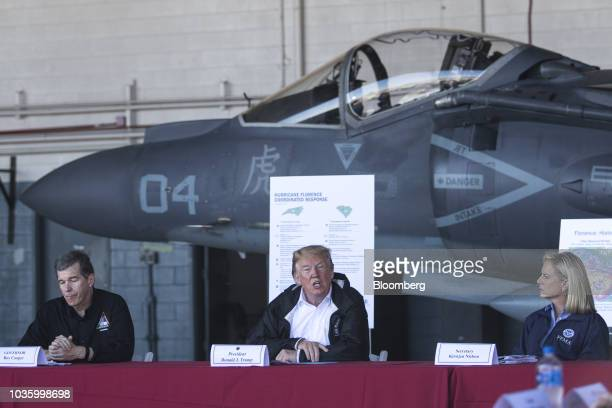 US President Donald Trump speaks as Roy Cooper governor of North Carolina left listenS during a briefing at Marine Corps Air Station Cherry Point in...