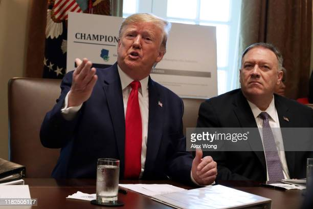 S President Donald Trump speaks as Secretary of State Mike Pompeo listens during a cabinet meeting in the Cabinet Room of the White House October 21...