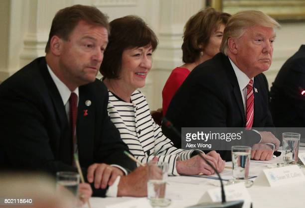 President Donald Trump speaks as Sen. Dean Heller and Sen. Susan Collins listen during a meeting with Senate Republicans at the East Room of the...