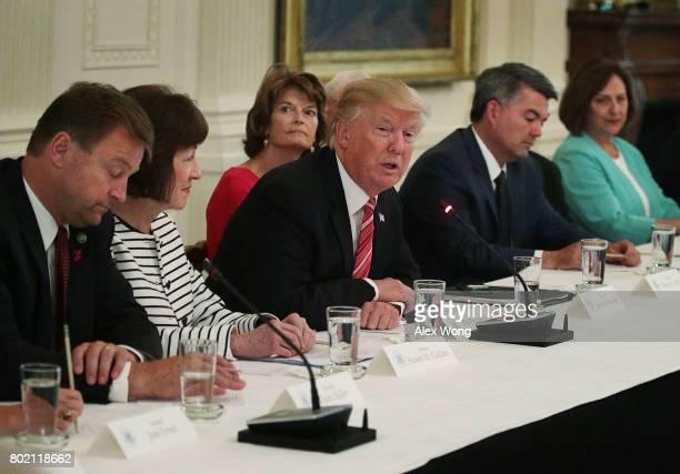 S President Donald Trump speaks as Sen Dean Heller Sen Susan Collins Sen Lisa Murkowski Sen Cory Gardner and Sen Deb Fischer listen during a meeting...