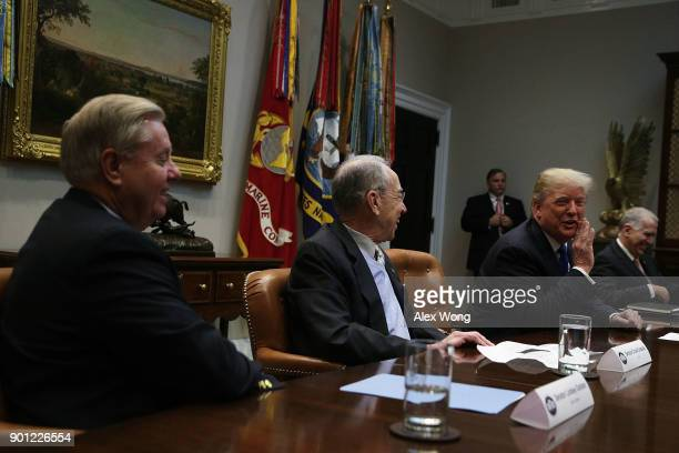 US President Donald Trump speaks as Sen Lindsey Graham Sen Chuck Grassley and Sen Thom Tillis listen during a meeting in the Roosevelt Room of the...