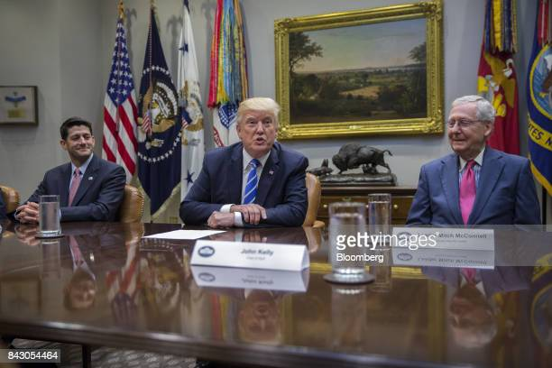 US President Donald Trump speaks as Senate Majority Leader Mitch McConnell a Republican from Kentucky right and US House Speaker Paul Ryan a...
