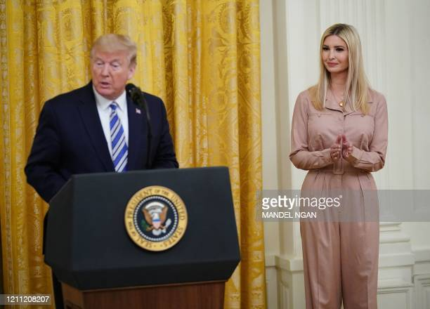 President Donald Trump speaks as Senior Adviser to the President Ivanka Trump looks on during an event on protecting small businesses through the...