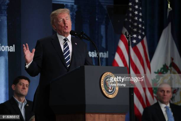 S President Donald Trump speaks as Speaker of the House Rep Paul Ryan and House Majority Whip Rep Steve Scalise listen during a lunch at the 2018...