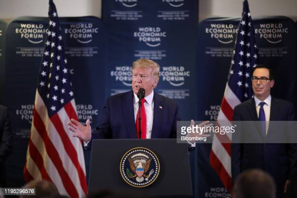 US President Donald Trump speaks as Steven Mnuchin US treasury secretary watches during a news conference on day two of the World Economic Forum in...