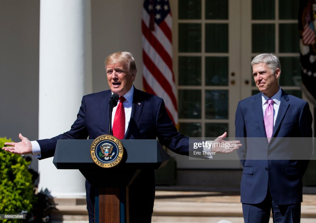 U.S. President Donald Trump speaks as Supreme Court Associate Justice Neil Gorsuch looks on during a ceremony in the Rose Garden at the White House April 10, 2017 in Washington, DC. Earlier in the day Gorsuch, 49, was sworn in as the 113th Associate Justice in a private ceremony at the Supreme Court.