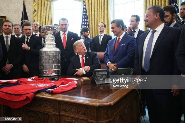 S President Donald Trump speaks as team owner of the Washington Capitals Ted Leonsis and team members including left wing and MVP Alexander Ovechkin...